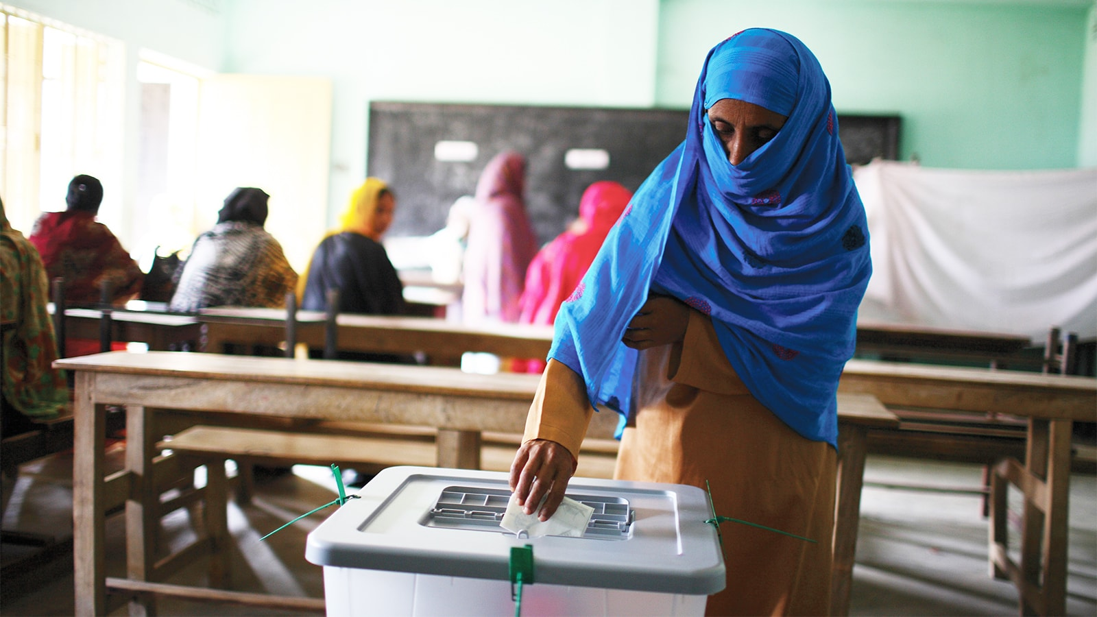 A woman votes in the general election Bangladesh 2009